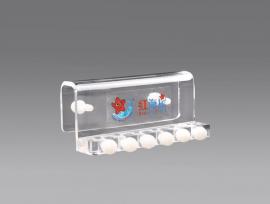 Acrylic dosing tube clamp